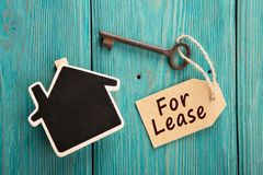 Real estate lease concept. Old key with tag royalty free stock images