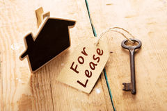 Real estate lease concept. Old key with tag Stock Photo