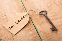 Real estate lease concept. Old key with tag Stock Images