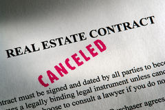 Real Estate Legal Contract with Canceled Ink Stamp. Canceled stamp red ink imprint on a Realtor real estate home sale contract (fictitious document with Royalty Free Stock Photography