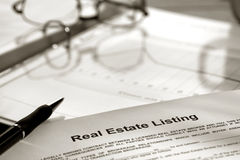 Real Estate Listing Contract Documents and Ink Pen stock image