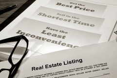 Real Estate Listing Contract on Marketing Material. Real estate listing contract over professional realtor agent marketing and advertising presentation binder Royalty Free Stock Photo