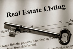 Real Estate Listing Contract and Old House Key. Real estate broker home sale listing contract and old fashioned house skeleton key Stock Photo