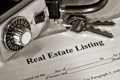 Real Estate Listing Contract and Realtor Lock Box Stock Photo