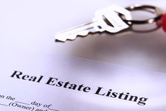 Real Estate Listing Contract and Resale House Key. Real estate broker agent listing contract and key on a keychain (fictitious document with authentic legal Stock Photos