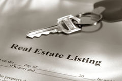 Real Estate Listing Sale Contract and House Keys. Real estate broker residential house sale listing contract paperwork and key on a Realtor desk Stock Image