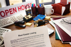 Real Estate Listing Sale Contract on Realtor Desk. Real estate broker listing house sale contract over busy Realtor desk in realty agent broker resale office (