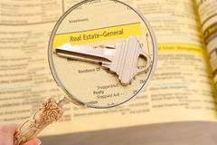 Real estate listings. Looking for real estate listings in the phone book Royalty Free Stock Photos