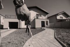 Real estate. Man holding the keys for the new house, real estate agency stock photos