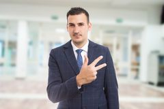Real estate manager showing number three or third stock images