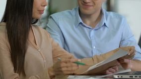 Real estate managers researching market, analyzing data graphs, action plan. Stock footage stock video