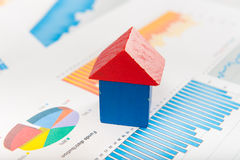 Real estate market concept. With graphs and house from toy blocks Stock Photo