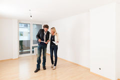 Young couple looking for real estate. Real estate market - young couple looking for real estate to rent or buy an apartment stock photos