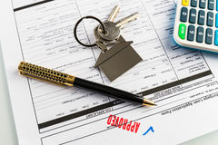 Real Estate Mortgage Approved Loan Agreement. Mortgage Approved Loan Document With House Keys and Ball Pen Stock Images