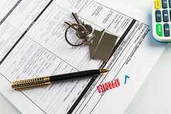 Real Estate Mortgage Approved Loan Agreement. Mortgage Approved Loan Document With House Keys and Ball Pen Stock Image