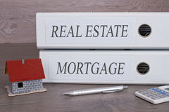 Real Estate and Mortgage binders with house or home Royalty Free Stock Photo