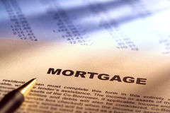 Real Estate Mortgage Document on Financial Figures. Residential real estate mortgage application document form over financial figures paperwork for a loan Stock Photography