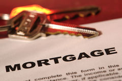 Real Estate Mortgage Loan Document with House Keys Stock Images