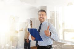Realtor with clipboard showing thumbs up Stock Image