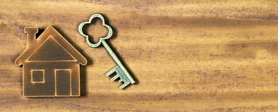 Real estate, new own home honcept, key and wooden house, web banner