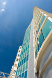 Real estate object. Tall office building made with glass and metal Stock Photography