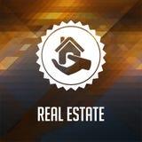 Real Estate op Driehoeksachtergrond. Royalty-vrije Stock Foto