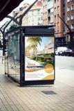 Billboard real estate poster advertising on bus stop. Real estate poster advertising billboard on bus station stock image