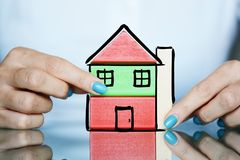 Real estate project with colorful wooden cubes as a house in woman hands Royalty Free Stock Photo