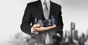 Real estate property concept, Business real estate agent holding modern buildings on hand. Real estate property concept, Business real estate agent holding Stock Images