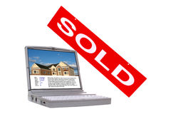 Real Estate Property Listing Screen and Sold Sign. Real estate multiple listing service property listing display on laptop computer screen with Realtor sign sold Royalty Free Stock Image