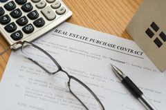Real estate purchase contact with an architectural model a c Royalty Free Stock Photos