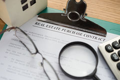 Real estate purchase contact with architectural model and calculator Stock Photo