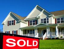 Real Estate Realtor Sold Sign and House for Sale stock images