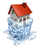 Real Estate Recovery. Symbol with a house in melting  ice as a housing concept of improving home buyers and sellers economy with debt relief and a better Royalty Free Stock Photo
