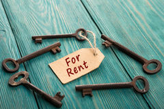 Real estate rent concept. Real estate concept - old key with tag Stock Photos