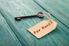 Real estate rent concept. Old key with tag royalty free stock images