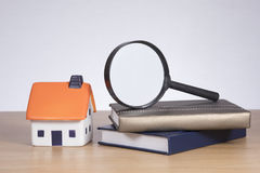 Real estate research concept with magnifying glass Royalty Free Stock Photo