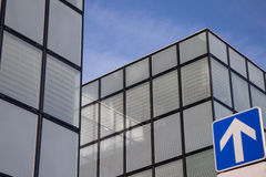 Real estate rising. Up arrow street sign next to office building suggesting real estate is rising Stock Photography
