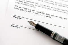Real estate sale. Legal document for sale of real estate property, with a fountain pen Stock Images