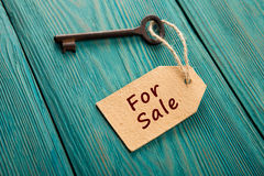 Real estate sale concept. Old key with tag Stock Photo