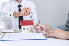 Real estate Sales manager giving keys to customer after signing royalty free stock images