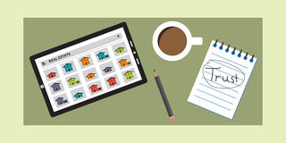 A Real Estate Search App Users Can Trust. A real estate search app being used on a tablet next to a mug of coffee, pencil and a notebook that displays the word Royalty Free Stock Images