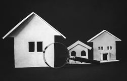 Real estate searching. Magnifying glass with houses Royalty Free Stock Photography