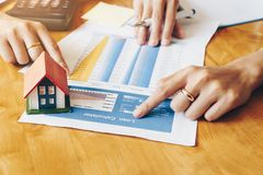 Real estate services for buying home calculating table installment payment to customer. Real estate services for buying home calculating table installment royalty free stock images