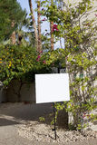 Real estate sign board outside house Royalty Free Stock Image