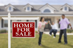 Real Estate Sign and Hispanic Family in Front of House Royalty Free Stock Photography