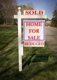 Real estate sign with sold and reduced Royalty Free Stock Photography