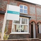 Real Estate Sold Board Outside Terraced House stock images