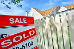 Free Real Estate Sold Rider On For Sale Sign Near House Royalty Free Stock Photo - 21179045