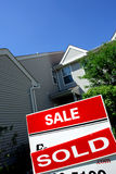 Real Estate Sold Rider on Sale Sign and Deal House Royalty Free Stock Photos